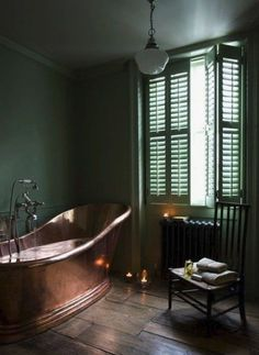 Dark green and copper bathroom