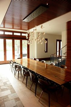 wood on ceiling to define dining area in open floor plan modern dining room by FRINGE STUDIO