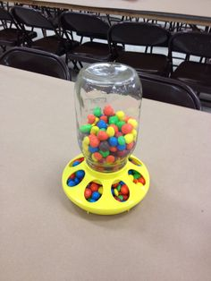 FFA Dinner Dance & Auction Candy Dish Centerpiece - plastic bottom of chicken feeder w/Mason jar filled w/Skittles or M&Ms.  Used as filler for long banquet tables fillers.