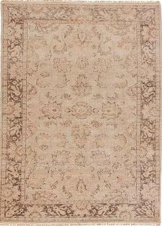 Sublime design: Tucker, an exquisite traditional pattern from the Raleigh Collection is hand-knotted in 100 percent wool. In sophisticated shades of Fog and Seneca Rock, it's a fine example of the craftmanship that sets fine rugs apart.