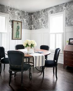 Metallic floral wallpaper in gray, white, and black palette has timeless appeal in this dinning room.