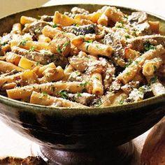 Ziti with Portobello Mushrooms, Caramelized Onions, and Goat Cheese pasta recipe via delish.com.