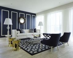 Simplicity of design meets elegance of palette in this space. The kismet connection between navy blue and white is undeniable. Reflective golden stools take on a modern shape yet are reminiscent of a traditional gilded past. Translucent curtains allow natural lighting to accentuate and soften the room. Simplified pattern in classic color defines this transitional space.