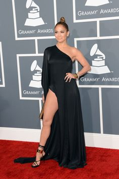 """GRAMMYS I love that Jennifer Lopez went back to her J-to-tha-L-O roots and ignored the """"memo"""" and showed so much skin in her Anthony Vaccarello gown. I don't think I've seen this much thigh since Angelina Jolie."""