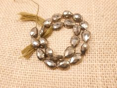Material:- Pyrite Gemstone  Size:- 7x12mm-8x12mm Approx  Shape :- Pear Beads  Length:- 9.5 long  Color :- Golden  Product Code :- GG-339  We are one of the prominent Manufacturer, Exporter and Supplier of precious and semi precious Stones like Beads, Nuggets, Briolettes, . These are exquisitely designed, durable and come at feasible prices from India.   We deal in very good quality products and maintain the quality of our products.We using the selected best rough materials for our beads…