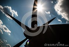 Photo about Blue sky clouds with bright sun and sun burst rays. Silhouette of an airplane bot, propeller. Image of vacation, summer, airport - 58793667 Airplane Outline, Airplane Silhouette, Blue Sky Clouds, Sun Rays, Air Show, Blue Backgrounds, Airplanes, Trail, Stock Photos