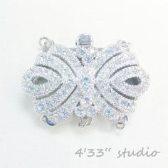 item no.:S-CL0016-3R-RH  925 SILVER (RHODIUM PLATING)  COLOR: WHITE GOLD  C.Z. STONE