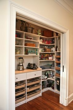 A closet for kitchen appliances - Open shelving and pocket doors to hide the clutter!