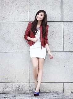 A leather jacket is not only warm, but it also adds a sense of toughness to the look. With the right accents and combinations such as this fitted dress and heels, an outfit can still maintain its femininity.