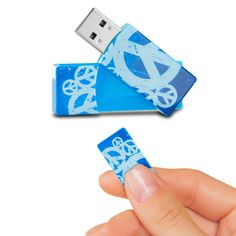 EMTEC Swivel Series 4GB USB 2.0 Flash Drive (Peace Signs 2) Stop using boring flash drives, and give your flash drive a little personality with the EMTEC Swivel Series 4 GB USB 2.0 Flash Drive. This small, compact flash drive features a fun peace sign design on the front and includes 4 GB of storage capacity. Now, you can store and transport all your most important photos, videos, music, and files. The flash drive features a swivel design so the USB connector easily swings in and out of the…