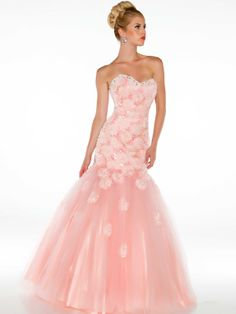 Blush pink dresses are all over celebrity red carpet events and the Mac Duggal prom dress 64315H is a beautiful mermaid gown with a sweetheart neckline, fitted drop waist bodice covered in unique rosettes and sequins that trail down into the tulle fish tail skirt. The back features a subtle low cut that will have you feeling like a star on your prom night!