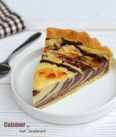 Mi-flan pâtissier, mi-marbré au chocolat, il faut bien l'avouer, ce gâteau a du style !Comment on fait ? On verse alternativement sur une pâte brisée une cuillérée de pâte nature et une cuillérée de pâte chocolatée, jusqu'à épuisement des ingrédients....