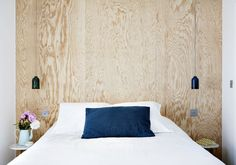 White Bed Blue Pillow Wooden Wall Hotal Henriette