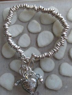 Sterling silver sweetie bracelet with toggle clasp and charm cluster of Murano glass foil heart, Swarovski crystals and sterling silver beads