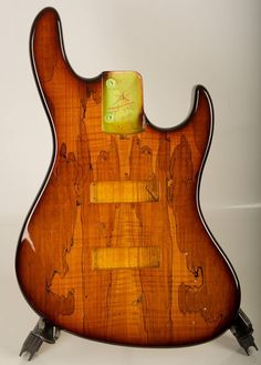 Sadowsky Guitars Ltd.  Master grade Spalted Maple top on chambered Swamp ash body, finished in our Narrow band 59 Burst.