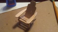 How To Make A Popsicle Stick Mini Adirondack Chair -- here's an actual tutorial!
