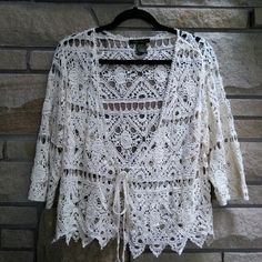 Cream crochet knit cardigan boho festival top Beautiful cream crochet knit cardigan. Has tie waist. New. So boho trendy! Large Forever 21 Tops