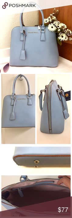 """Adrienne Vittadini City Slicker Dome Satchel Brand new with tags. Be the epitome of sophistication carrying this gorgeous dome Satchel by Adrienne Vittadini in a chic sky blue color. Crafted in beautiful faux leather. The bag is fully lined and features an all round zipper, one main compartment, interior accessory pockets and signature zippers. Dimensions: 11""""X14""""X6"""". Comes from a smoke free home. Reasonable offers will be accepted :) Adrienne Vittadini Bags Satchels"""