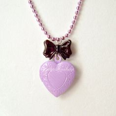 Kawaii Pastel Goth Necklace Gothic Lolita Purple Locket Black Bow. $7.00, via Etsy.