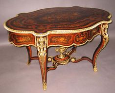 A Very Fine French 19th Century Louis XV Style Gilt-Bronze Mounted Tulipwood, Kingwood and Fruitwood Floral Marquetry Center Table with Draw...