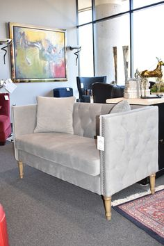 Chic and simple. This high back, grey, velvet love seat screams elegance and glam. We think this would look great in the master bedroom or even a dressing room if you are so lucky to have one.