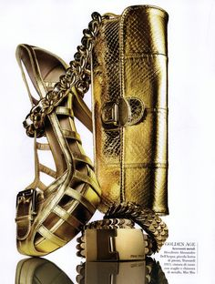 https://www.myfdb.com/editorials/42482/image/127301-flair-editorial-f-next-june-2009-shot-10 My Fashion Database: Flair Editorial f Next, June 2009 Shot #gold #platform #sandal #clutch #bracelet #fashion #photography #magazine #editorial #MYFDB