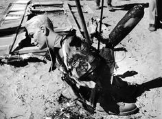 """From Life Magazine, 1955. Nuclear Detonation Tests """"Burned up except for face, this mannequin … was 7,000 feet [one and a quarter miles] from blast."""""""