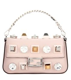 Fendi - Micro Baguette leather shoulder bag - Inject some sophistication into your evening looks with this Micro Baguette Fendi bag. Made from smooth blush leather and studded with signature studs and oversized crystal embellishments, the compact style is perfect for your phone, make-up and keys. Carry it against sleek separates and elegant sandals. seen @ www.mytheresa.com