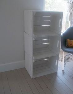 Wooden Crates painted white to create bookshelf