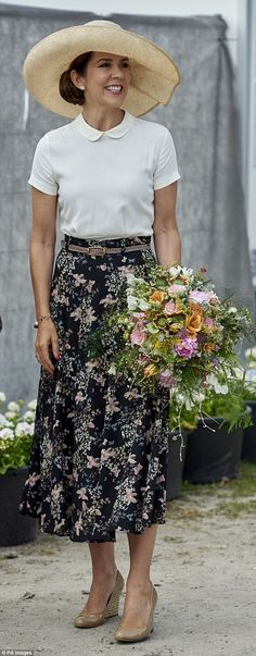 For the joyful occasion, Princess Mary opted for a midi skirt featuring florals by the acclaimed Finnish fashion label, Andiata (pictured)