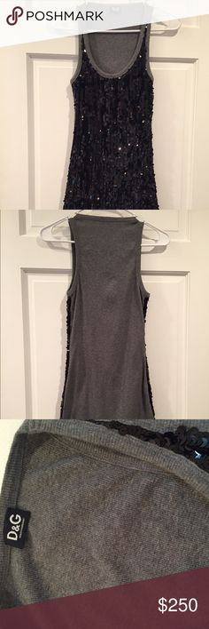 """⚜💯Dolce & Gabbana sequin tank top Mint condition, never worn, but with no tags. Would look killer with a pair of leggings or jeans and your favorite heels!  Could be worn as a short dress depending on body type.  Any questions feel free to ask.   Gray/Heather thick ribbed cotton blend material on the back panel of the shirt with a beautiful black sequin overlay on the front.   Size: It's stretchy and should fit most S-M sizes. It's about 32"""" long.  (could be worn as a short dress) D&G Tops…"""