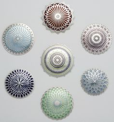Jasmine Watson--This series of sterling silver and enamel brooches are made using hand piercing, casting, and the champlevé technique; they combine layered and intricately pierced silhouettes with delicately blended gradients, which can assemble to form elaborate ornamental sequences, repeating to infinity.