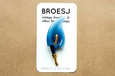 Blue and gold pin