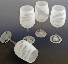 A set of four glasses depicting great white, hammerhead, black tipped reef and thresher sharks! Patterns are permanently frosted onto the glass with an additional sharky detail under the foot.