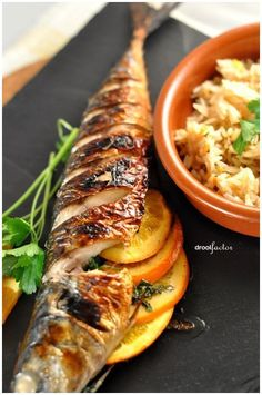 """Grilled Mackerel with Orange & Parsley Do you know how the term 'Holy Mackerel' came about? I just found this out through our beloved Wiktionary. """"Recorded from 1803 with uncertain origin, but possibly a euphemism for … Fish Dishes, Seafood Dishes, Fish And Seafood, Seafood Recipes, Cooking Recipes, Seafood Appetizers, Tilapia Recipes, Cooking Tips, Grilled Fish Recipes"""