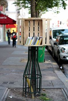Strasbourg-based street artist Florian Rivière installed a little library on a sidewalk near the Gare du Nord, Paris. Click image to tweet and visit the slowottawa.ca boards >> http://www.pinterest.com/slowottawa/