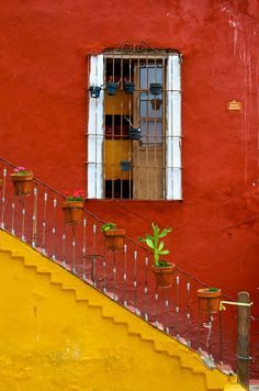 yellow stairs framing a window in Guanajuato, Mexico (by Bob Boyer)