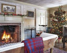 In this 1815 Cape-style cottage, the homeowners used a steam machine to remove early-20th-century wallpaper from the wide horizontal paneling, thus revealing its 19th-century whitewash.