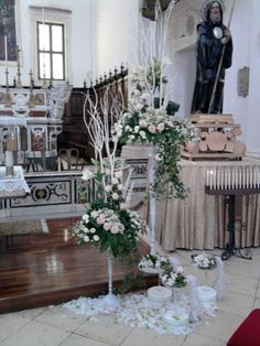 white and pink flowers in church