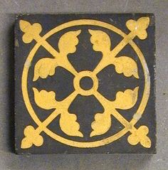 "Craven Dunnill dust-pressed encaustic tile, four-fold floral design within a circle with trefoils pointing toward the corners, two colour, 3"" square, c1890. A very popular design produced in a number of colourways"