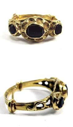 Likely Spanish or Italian in origin, 22k gold, this ring displays a combination of transitional mid 17th-century styles. The flat-cut garnets are set in closed-backed, rubbed-over collets of 22k gold boasting the deeply-fluted cusps more typically associated with Tudor rings of the late 16th/ early 17th centuries. The gold scrolls to the shoulders and fluted shank is more typical of rings of the late 17th-century, when the Baroque movement led to more restrained jewelry designs.