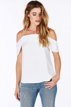 An adorable Summer top made of smooth material to keep you cool in the heat. Chic cold shoulder d...