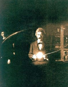 Mark Twain holds a loop so the current passes through his body and turns on the lamp. His friend, Nikola Tesla, watches him in the background.