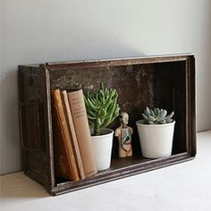 Industrial storage, perfect for storing and displaying vintage treasures and plants. (photo via Oh, Albatross)