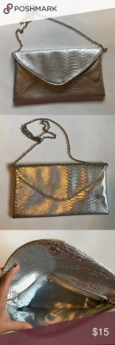 Large Silver Clutch Crossbody Silver snake skin clutch. Use to carry essentials! In perfect condition Bags Clutches & Wristlets