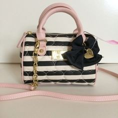 "Betsey Johnson adorable crossbody bag! The most adorable bag you ever saw!  The stripes, the baby pink, the bow with the heart-shaped charm, the gold hardware - just perfect!     Would make an awesome gift for a teenager's starting bag! ❤️❤️❤️ I have two of these for sale, so buy both and keep one for yourself!    Bag measures about 8"" by 6"" by 4"".  Strap is not adjustable, but is 53"" - a great length! Betsey Johnson Bags Crossbody Bags"