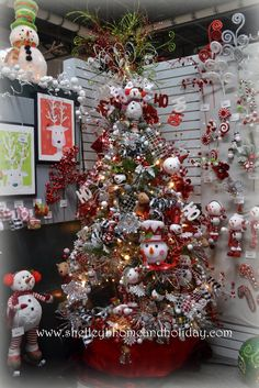 2013 Preview    RAZ Holiday on Ice      Decorated Christmas Tree      Filled with snowman themed ornaments, garlands and floral spra...