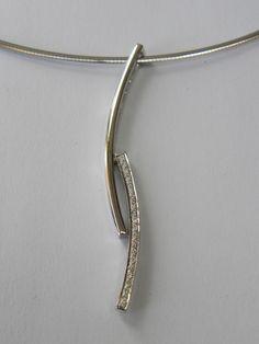 wit gouden hanger met briljant 0.10ct €450 (nr 987)