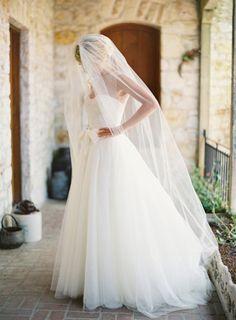 beautiful sheer sleeves and long veil.