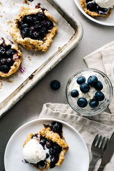 summertime perfection: mini blueberry pistachios galettes. jammy, sweet fruit & a crisp nutty crust!